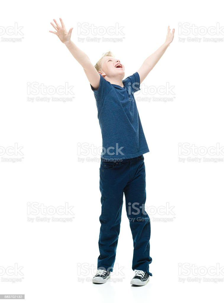 Cheerful male cheering with hands raised stock photo