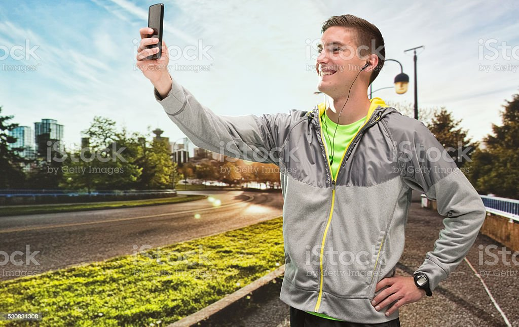 Cheerful male runner taking a selfie stock photo