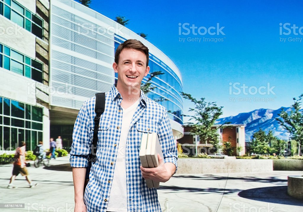 Cheerful male student at the university stock photo