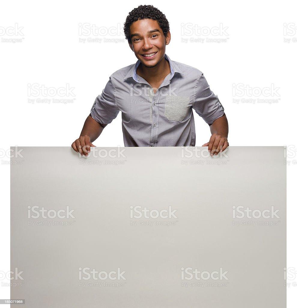 Cheerful man holding a blank billboard royalty-free stock photo