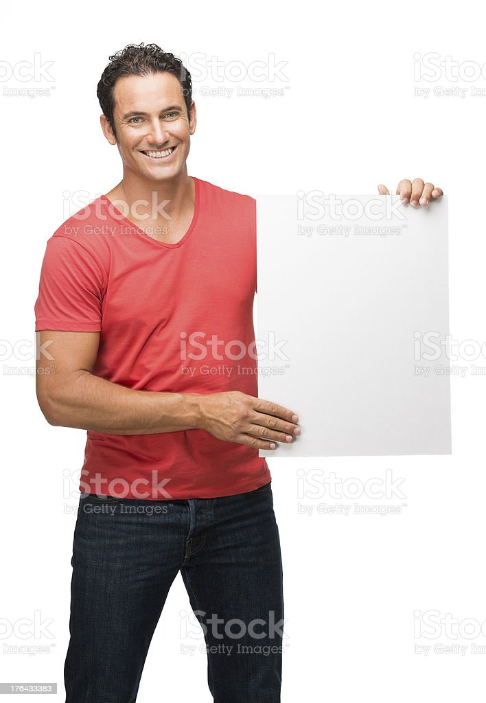 Cheerful man holding a blank sign royalty-free stock photo