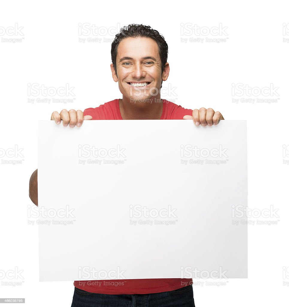 Cheerful man holding a sign royalty-free stock photo