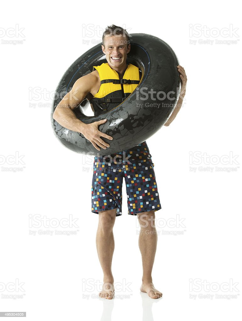 Cheerful man holding inner tube royalty-free stock photo