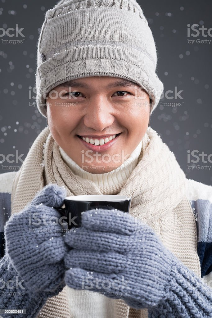 Cheerful man in winter clothes stock photo