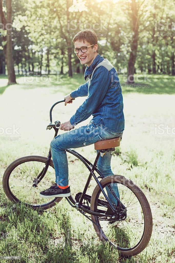 Cheerful man on a bicycle stock photo