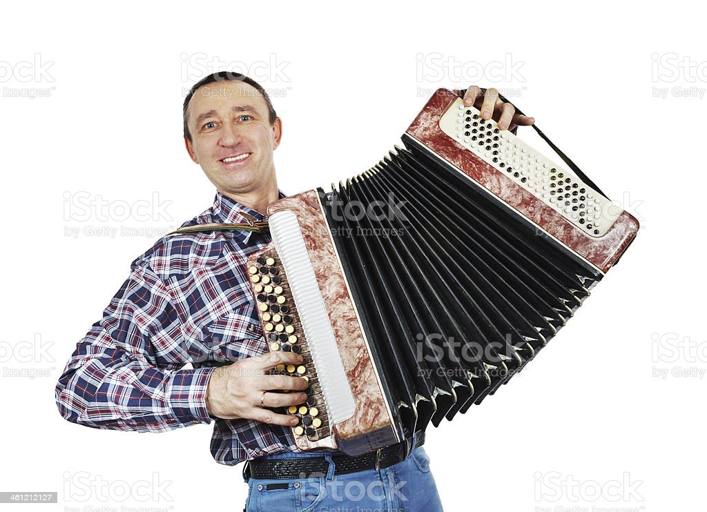 Cheerful man plays harmonica stock photo
