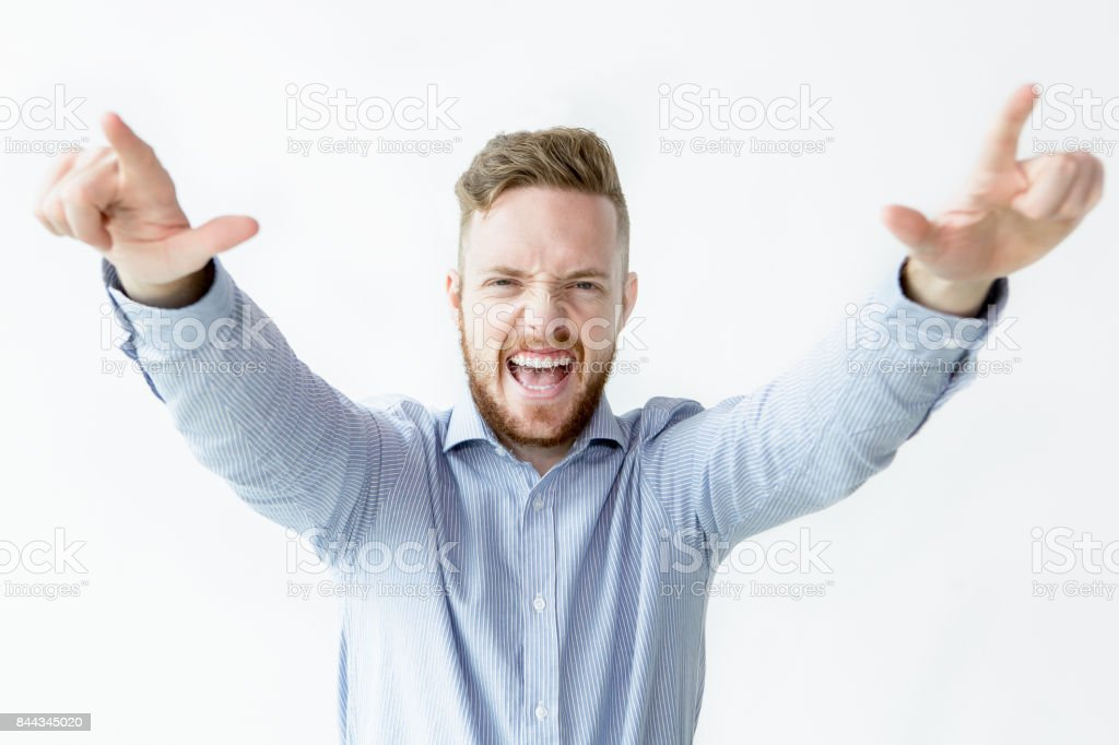 Cheerful Man Raising Arms and Screaming stock photo