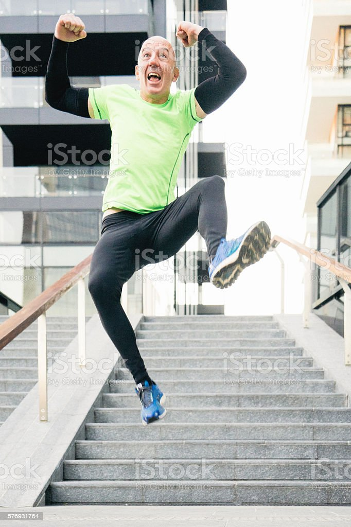 Cheerful Man Running And Jumping stock photo
