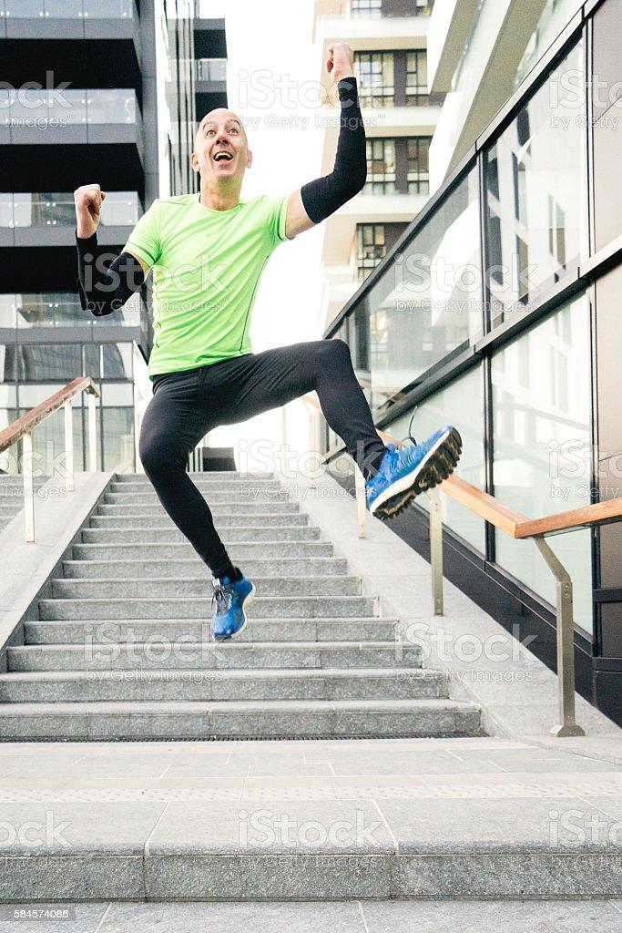 Cheerful Man Running And Jumping stock photo