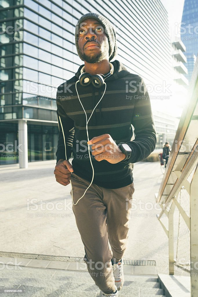 Cheerful Man Running Outdoors In The Early Morning stock photo