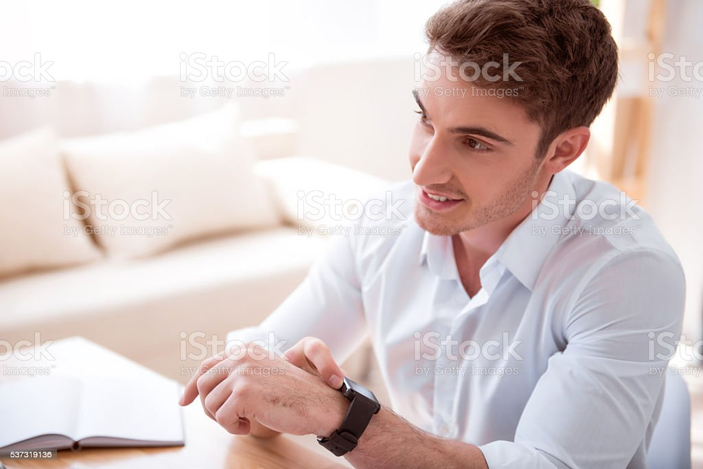 Cheerful man sitting at the table stock photo