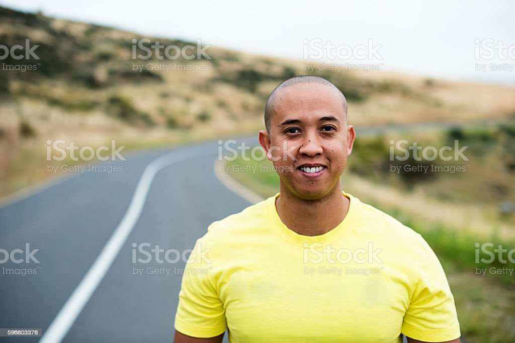 Cheerful Man Standing On A Tarred Road stock photo