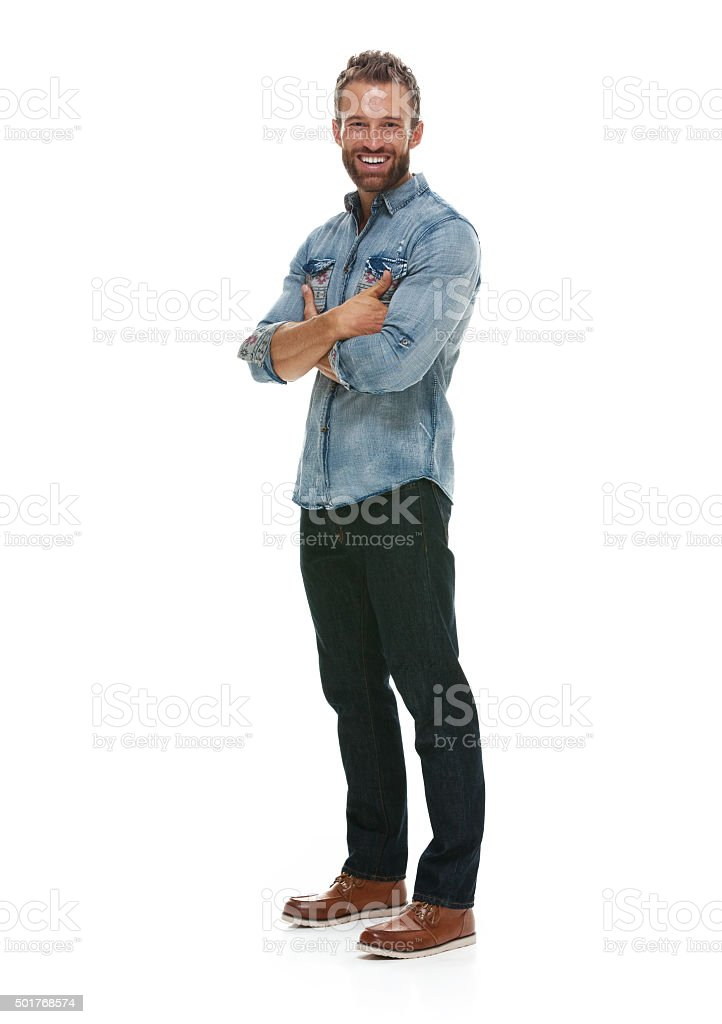 Cheerful man standing with arms crossed stock photo