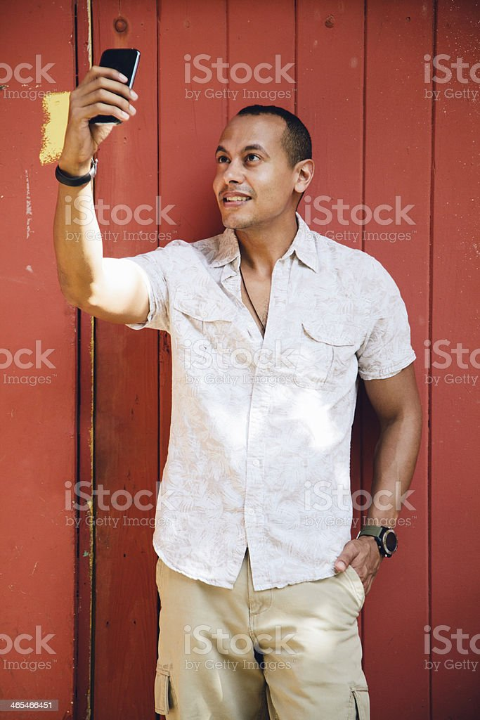 Cheerful man taking selfie stock photo