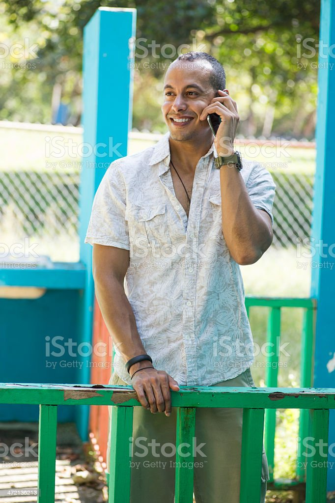 Cheerful man talking on his cell phone stock photo