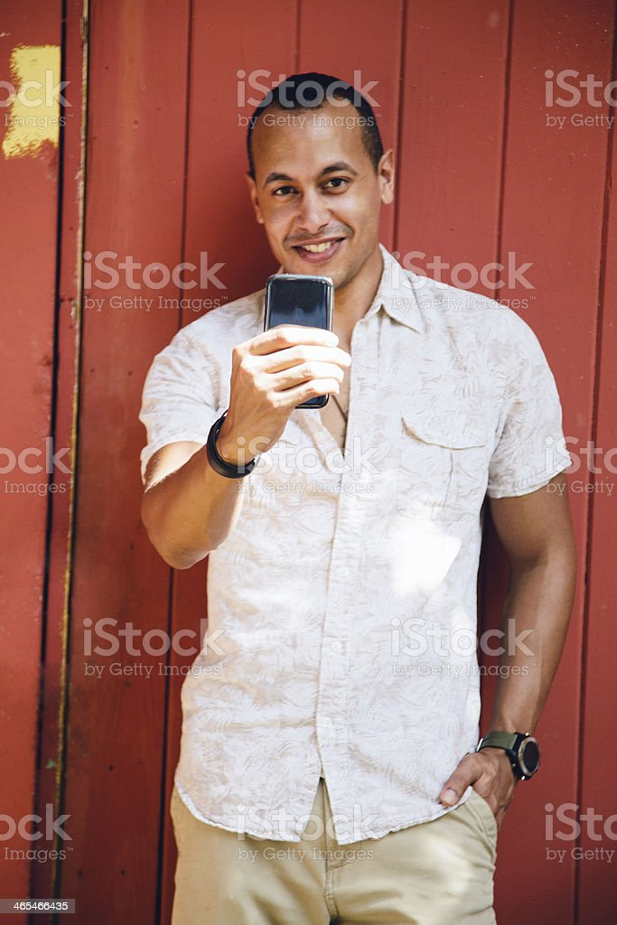 Cheerful man texting stock photo