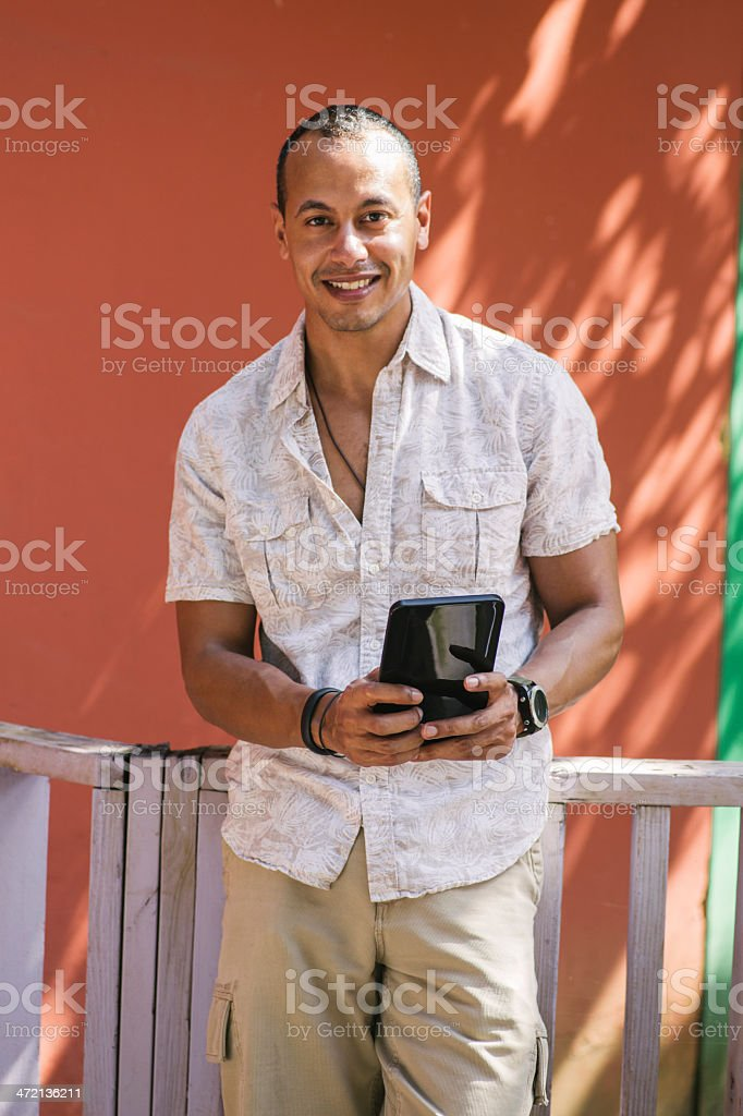 Cheerful man using a tablet stock photo
