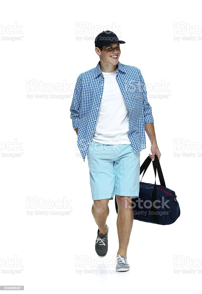 Cheerful man walking & looking away royalty-free stock photo