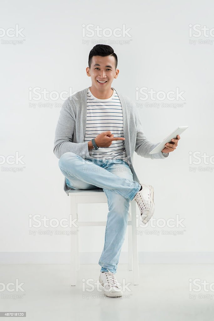 Cheerful man with tablet stock photo