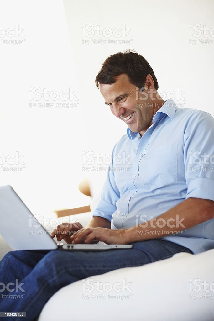 Cheerful man working on laptop royalty-free stock photo