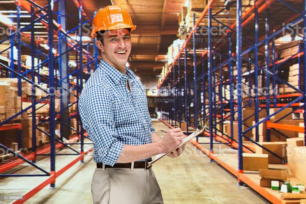Cheerful manager working in warehouse stock photo