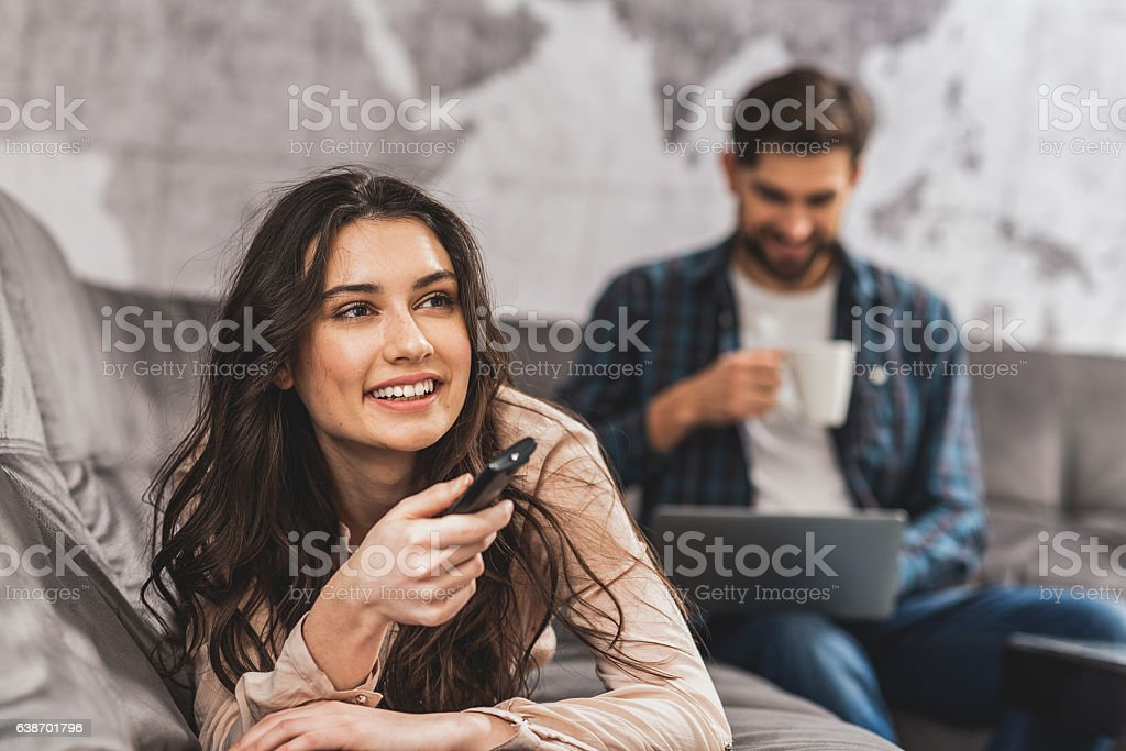 Cheerful married couple entertaining at home stock photo