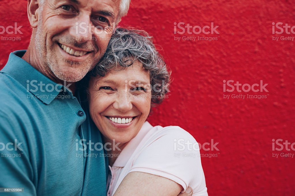 Cheerful mature couple embracing each other stock photo