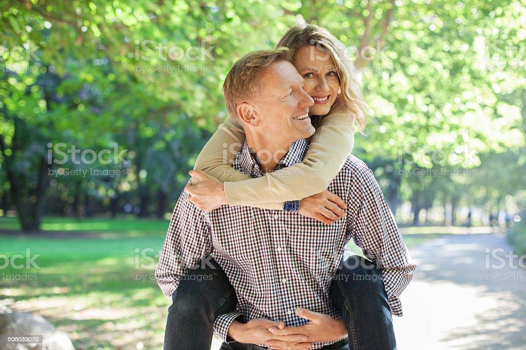 Cheerful mature couple having fun together stock photo