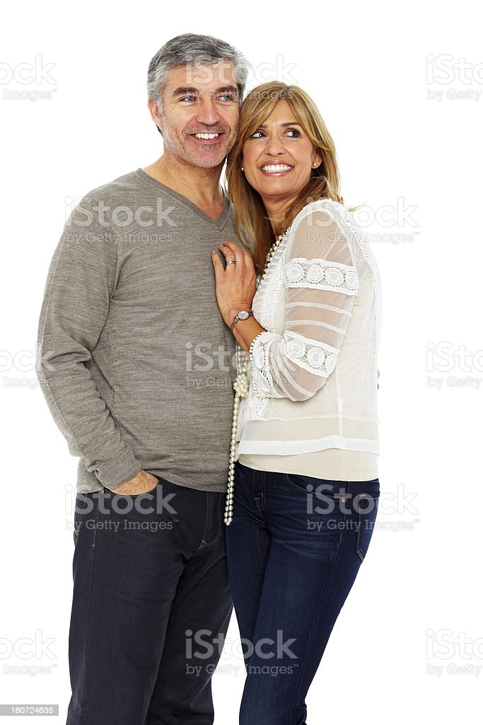 Cheerful mature couple together looking away royalty-free stock photo