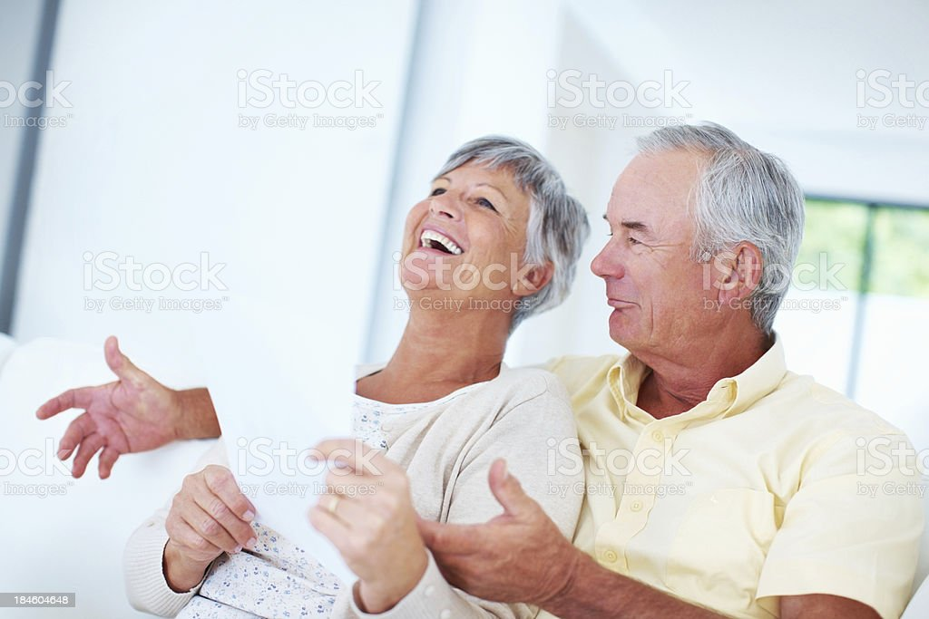 Cheerful mature couple with bills royalty-free stock photo