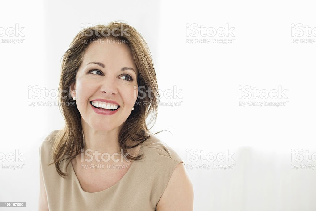 Cheerful Mature Woman Looking Away stock photo