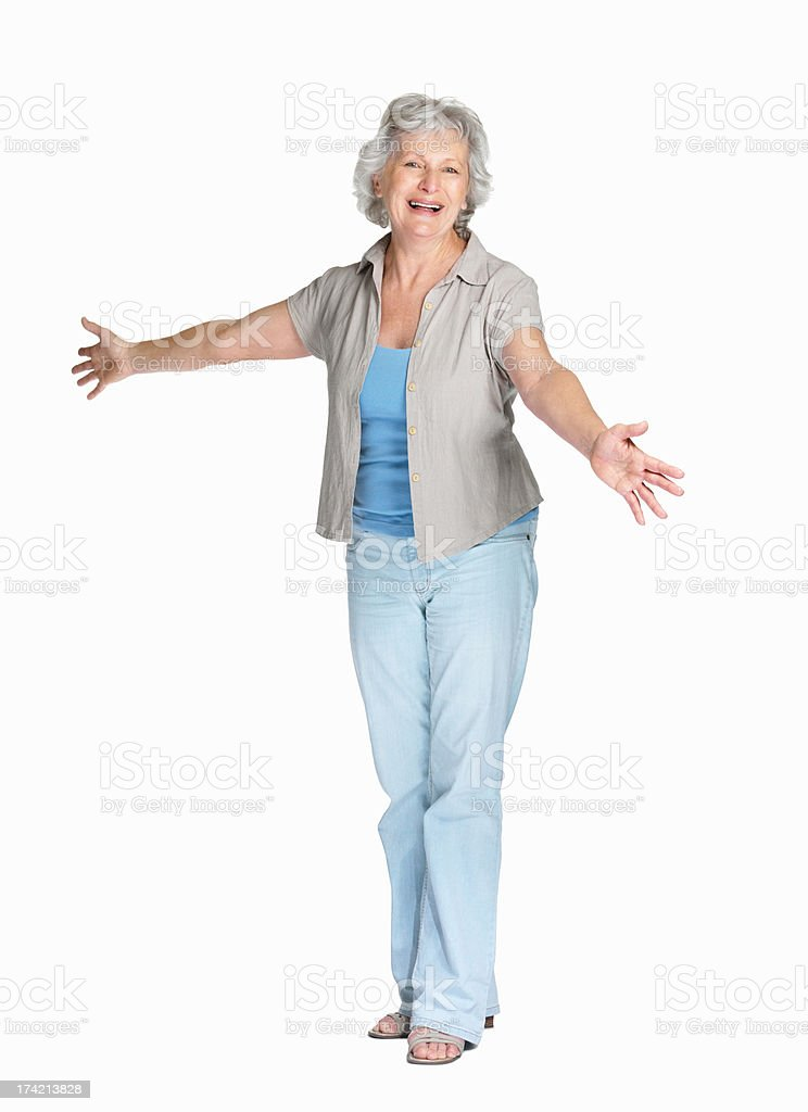 Cheerful mature woman standing isolated against white background stock photo