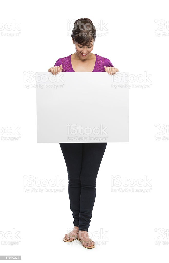 Cheerful mature women looking at a sign royalty-free stock photo