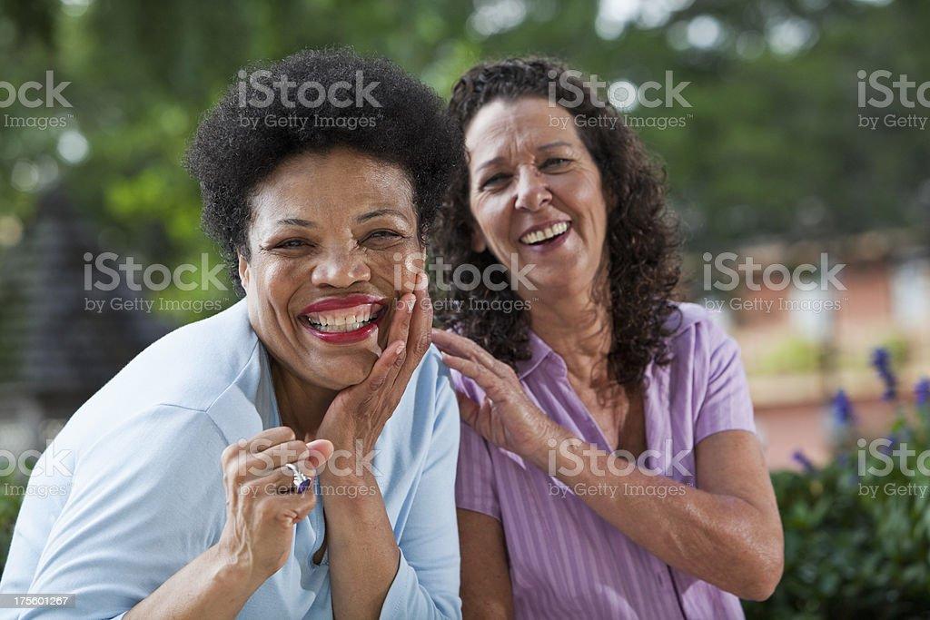 Cheerful mature women stock photo