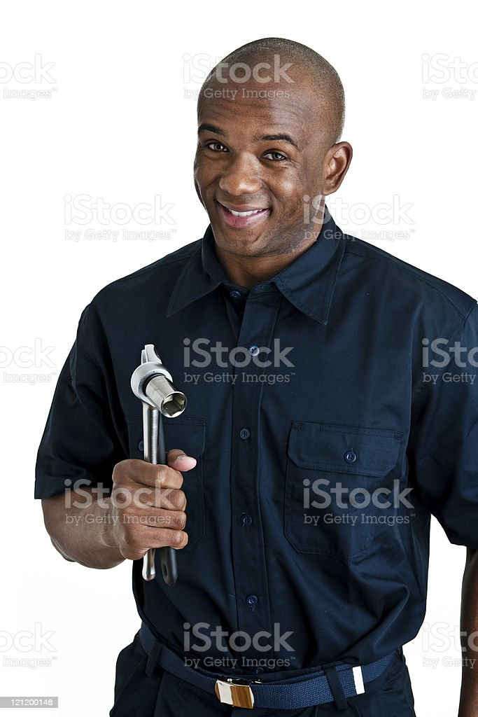 Cheerful mechanic holding tools stock photo