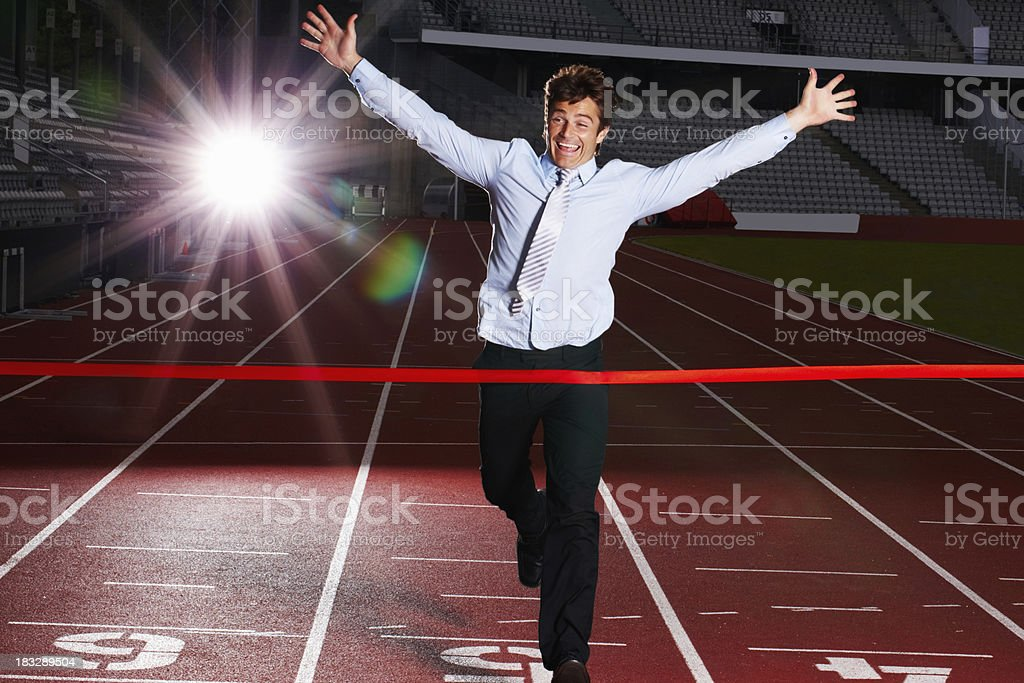Cheerful middle aged business man about to win a race royalty-free stock photo