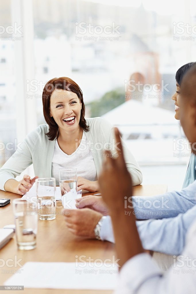 Cheerful middle aged woman in a meeting at office royalty-free stock photo