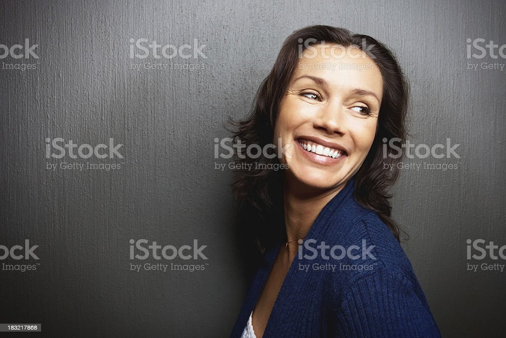 Cheerful middle aged woman isolated against wall - copyspace royalty-free stock photo