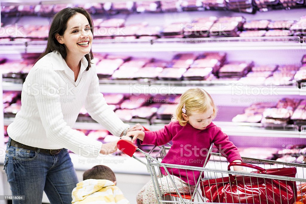 Cheerful mom shops with the kids stock photo