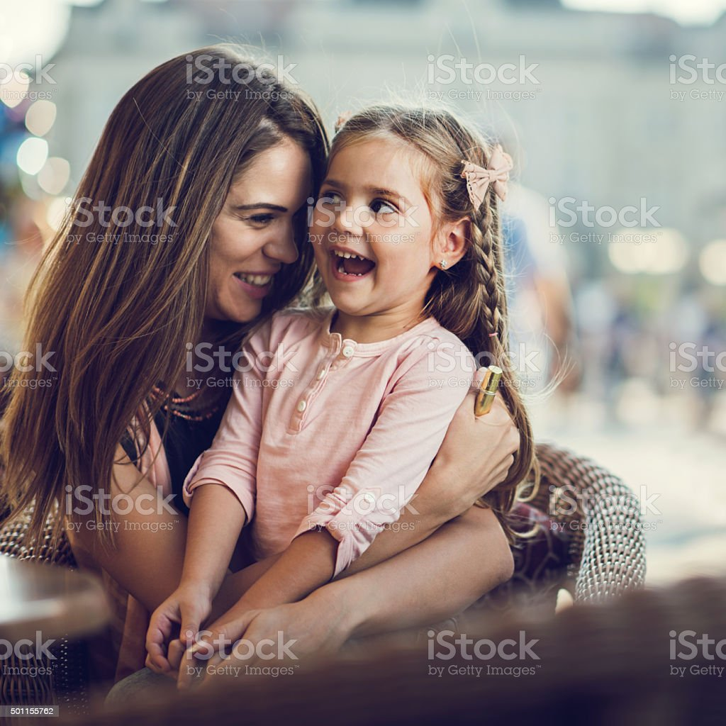 Cheerful mother and daughter enjoying a day together. stock photo