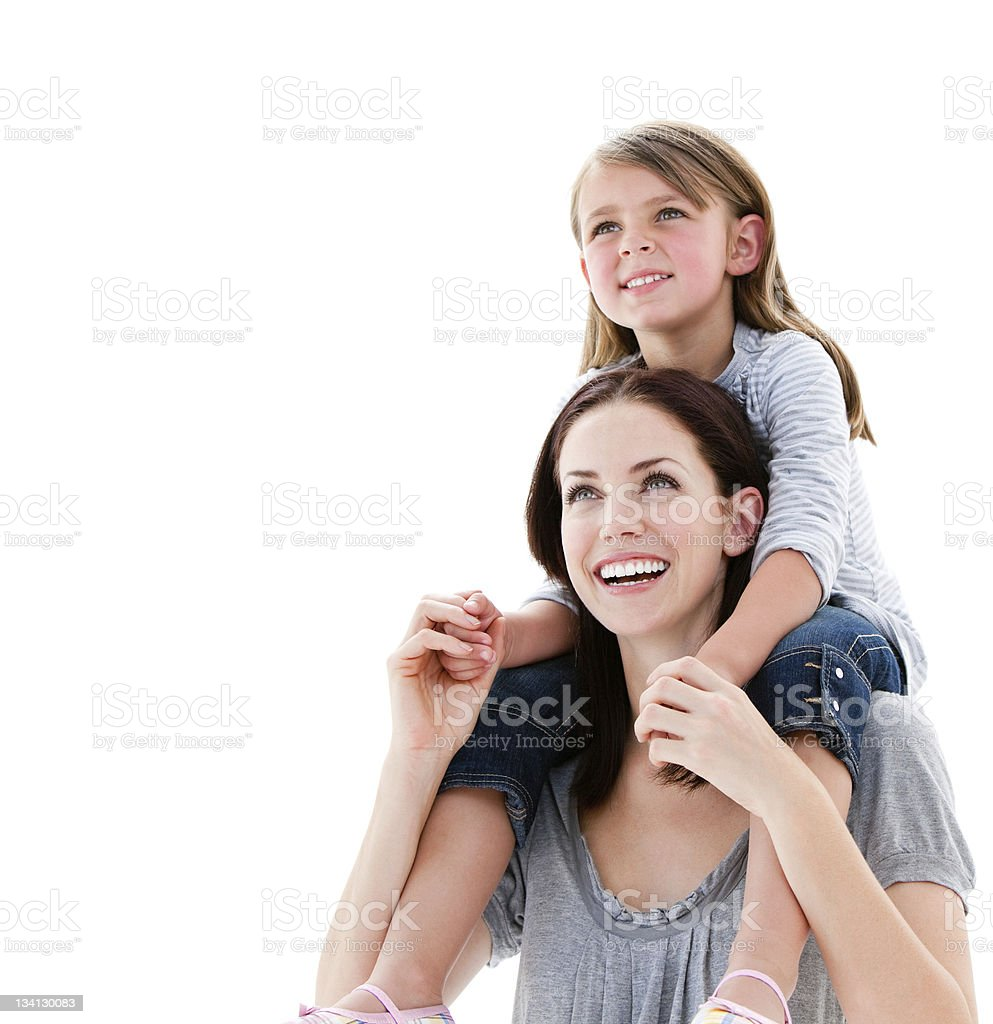 Cheerful mother giving piggyback ride to her daughter stock photo