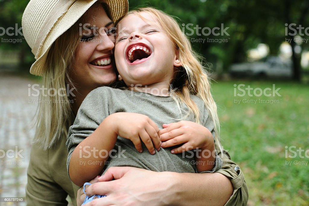 Cheerful mother with her daughter outdoor. stock photo