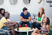 Cheerful multi-ethnic friends enjoying at house party