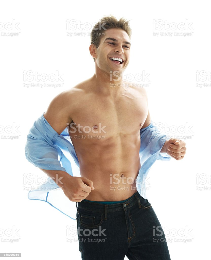 Cheerful muscular man looking away stock photo