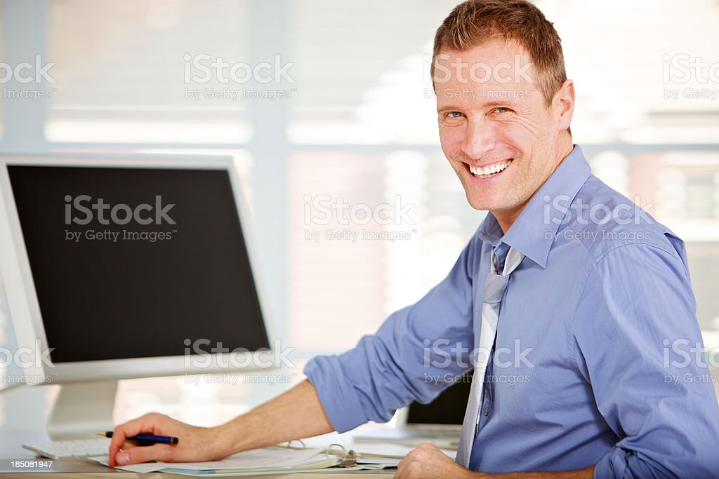 cheerful office worker looking at the camera royalty-free stock photo