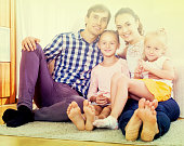 Cheerful parents with two daughters