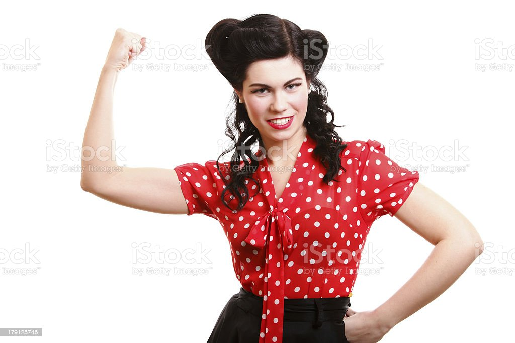 cheerful pin up woman flexing biceps isolated stock photo