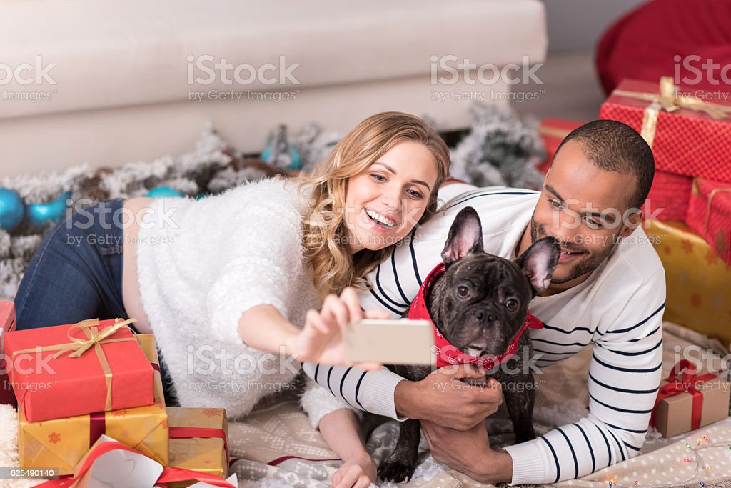 Cheerful positive woman taking selfies stock photo