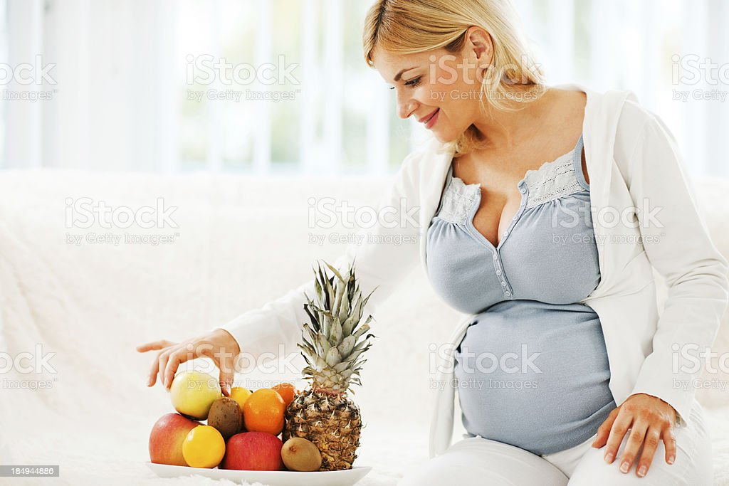 Cheerful pregnant woman eating healthy food royalty-free stock photo