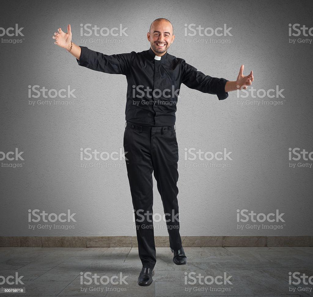 Cheerful priest stock photo